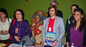 Maritzel  González-Quevido holds picture of<br>Cuban Five political prisoners at discussion<br>of women's status at UN.