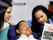 President Chávez's first public photo since his surgery in December. Taken Feb. 14 in Cuba, the smiling president is seen with his daughters Rosa Virginia and María Gabriela.