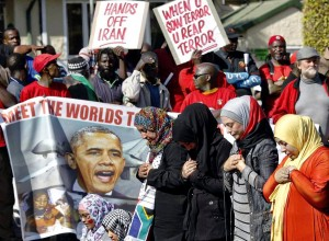 Protesters in front of the U.S. embassy during the visit of U.S. President Obama in Pretoria, South Africa, June 28.