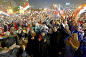 Protesters in Tahrir Square shout slogans against President Mohammed Morsi as they watch his speech. Cairo, Egypt, June 26.