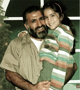 Yassin Aref with youngest daughter.