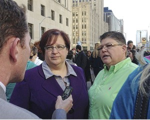 April DeBoer (left) and Jayne Rowse address media after rally, Oct. 16.