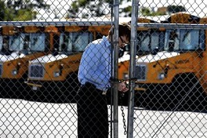 Justin Maynard, Veolia Director of Safety & Training, locks out drivers at the Freeport yard on the morning of Oct. 8.