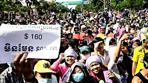 Workers protest in Phnom Penh to demand a higher minimum wage.