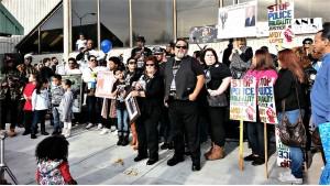 Family members of victims of police killings at Jan. 1 rally.WW photo: Terri Kay