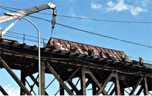 Derailed train dangles over West Philadelphia.WW photo: Joseph Piette
