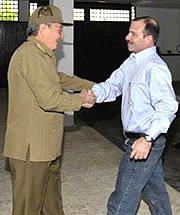 President Raúl Castro greets Fernando González, Feb. 28.