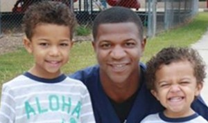 Alfred Wright with his two children.