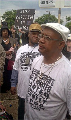 """Rev. Pinkney, right, at """"Occupy the PGA"""" protest, May 2012."""