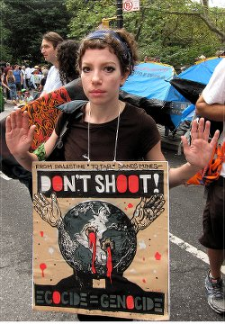 """Hands up, don't shoot"" activist at Climate Change March, New York City, Sept. 21.WW photo: G. Dunkel"