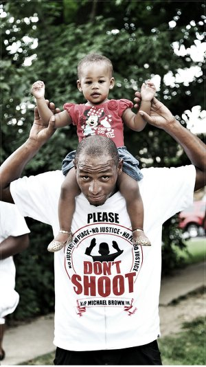 Parent and child at protest in Ferguson, Mo.