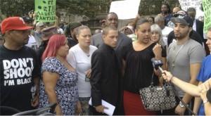 Ramsey Orta, center in suit, next to Chrissie Ortiz, speaking.WW photo: Johnnie Stevens