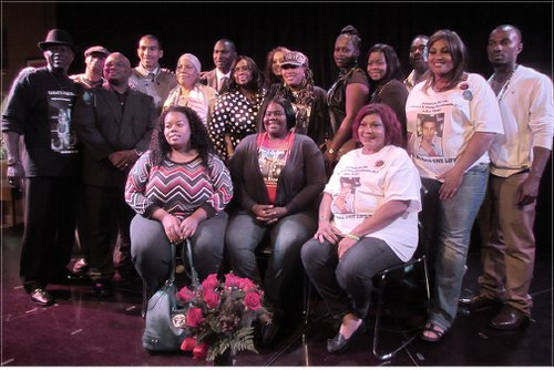 "Families take stage at ""Cost of Injustice"" meeting in Oakland, Calif. on Oct. 25.WW photo: Gloria Verdieu"