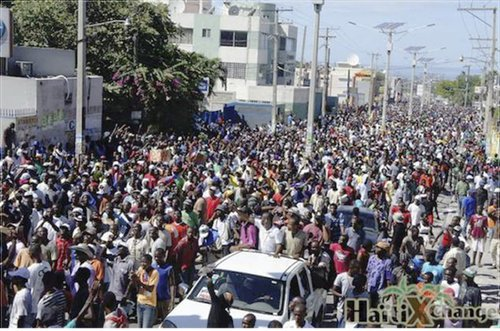 Haitians in Port-au-Prince demand president resign.