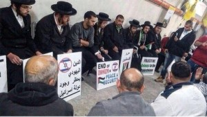 Rabbis from Orthodox Jews Against Zionism sit with the family of Palestinian bus driver Yousuf Al Ramouni, lynched by Zionist settlers in Jerusalem.WW photo