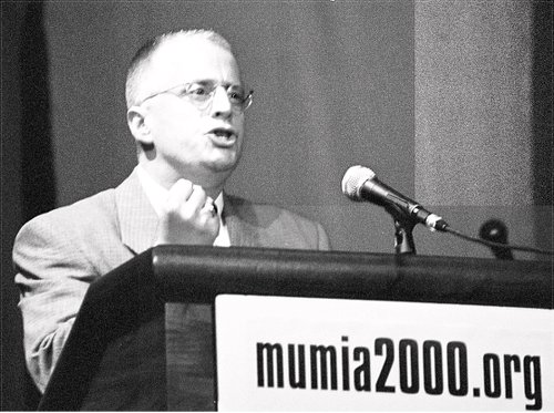 Leslie Feinberg speaks at Madison Square Garden Theater rally of 6,000 people in 2000 to demand freedom for political prisoner, Mumia Abu-Jamal.
