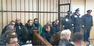 Anti-fascists held in cages at Odessa court.Photo: timer.od.ua