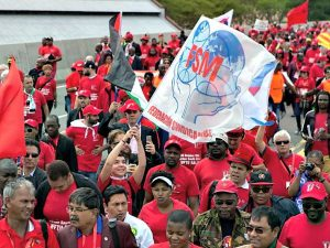 Workers march in Durban, Oct. 8.