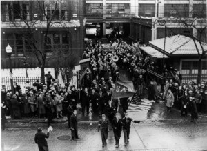 After occupying Chrysler's Dodge Main complex for over two weeks workers, confident of victory, march out singing Solidarity Forever, 1937.