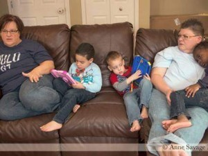 Nurses April DeBoer and Jayne Rowse at home in Michigan with three of their five dopted children.
