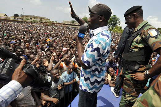 """Ivory Coast's Minister of youth and employment and leader of the """"young patriots"""" Charles Ble Goude in front of thousands of young supporters of Ivory Coast President Laurent Gbagbo, March 21, 2011 in Abidjan."""