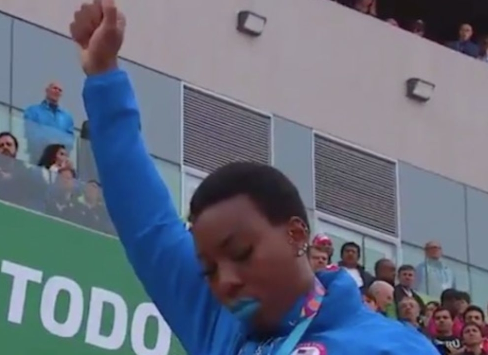Gwen Bailey raises fist