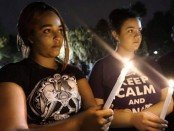 Somber faces at Houston vigil for Orlando victims.