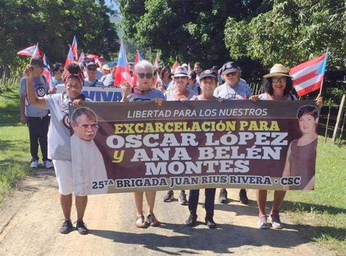 Puerto Rican Juan Rius Rivera Brigade of the Cuba Solidarity Committee during their last trip to Cuba, carrying a banner calling for the release of Oscar Lopez and Ana Belén Montes.