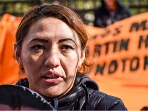 Alma Brigido speaking in front of ICE.