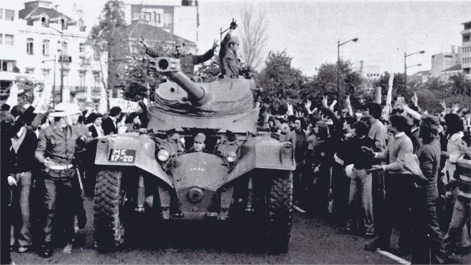 People cheer troops who turned their guns around after refusing to fight for the Portuguese fascist dictatorship against the liberation struggles in Africa.