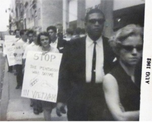 Deirdre Griswold carrying sign in August 1962 protest.