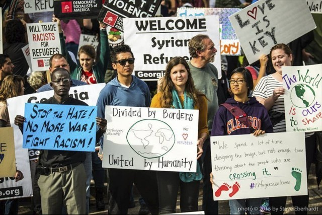"""""""Welcome to Georgia"""" say people at speakout in defiance of governor's exclusion of refugees.Photo: Steve Eberhardt"""