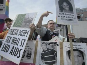 Ben Power marches with Stonewall Warriors for CeCe McDonald, Chelsea Manning and justice for Trayvon Martin, Boston Pride, 2012.WW photo: Stevan KIrschbaum