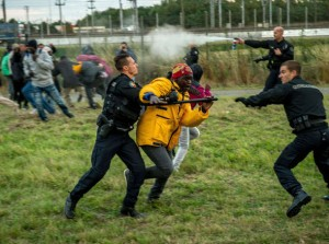 French gendarmes attack migrants on the Eurotunnel site in Coquelles near Calais.