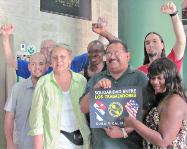 "A few members of the U.S. union delegation to 2016 May Day celebration in Cuba with ""Worker Solidarity - Cuba and California"" sign."