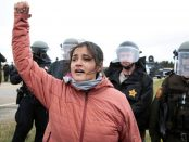 Ta'Sina Sapa Win of South Dakota's Cheyenne River Reservation chants in front of police during a protest against the Dakota Access Pipeline outside Saint Anthony, North Dakota, October 5, 2016.