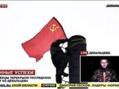 Ghost Brigade fighter raises red flag over Debaltsevo region.