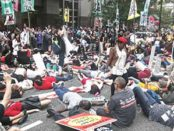 'Die-in' protest at headquarters of pharmaceutical industry.
