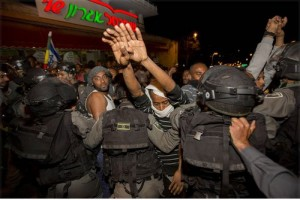 Police attack Africans in Israel.