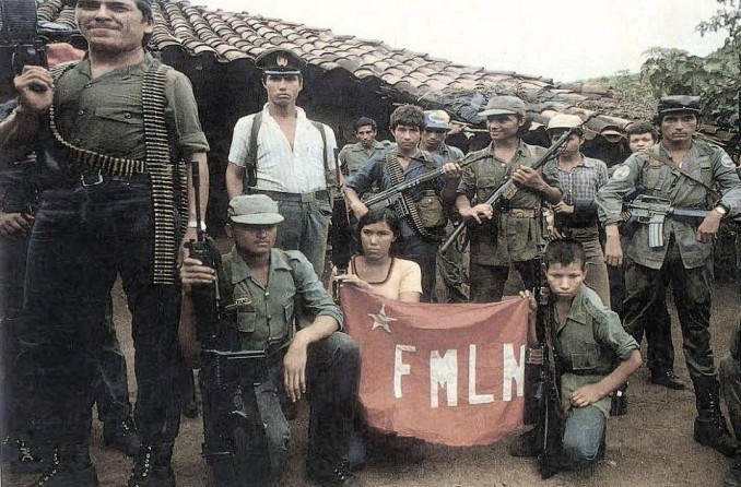 Members of the FMLN guerrilla army pose with the flag of the movement.