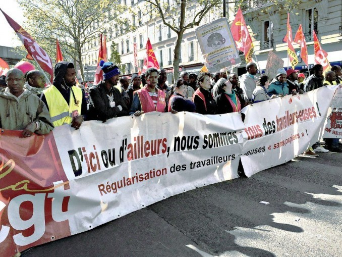 Contingent of undocumented workers in Paris march.