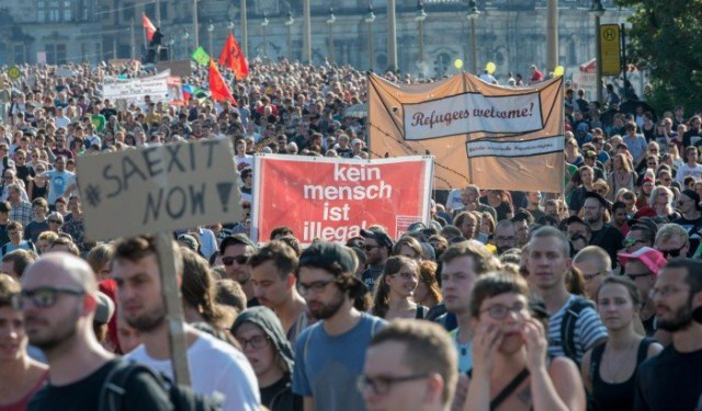 5,000 demonstrate in Dresden, Germany, on Aug. 29 in solidarity with migrants. Sign in center reads: 'No human being is illegal.'