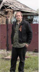 WW reporter Greg Butterfield near a destroyed house in Octoberski Village, Donetsk.