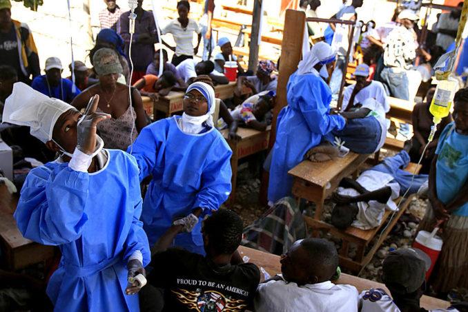 Cholera victims in Haiti await treatment.