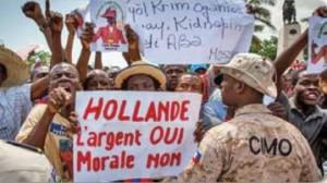 Haitians demonstrate against French president.