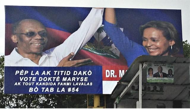 Billboard in Haiti shows Aristide's support.