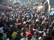 Demonstrators march during a protest in Port-au-Prince.