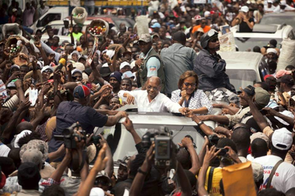 Aristide Returns to Campaign Trail After Fainting at Rally