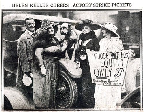 """""""I am a Socialist because only under socialism can everyone obtain the right to work and be happy."""" – Helen Keller, in black hat, supporting actors' strike, 1919."""