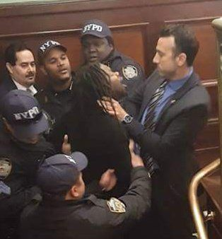 Imani Henry assulted at Mayor's hearing.